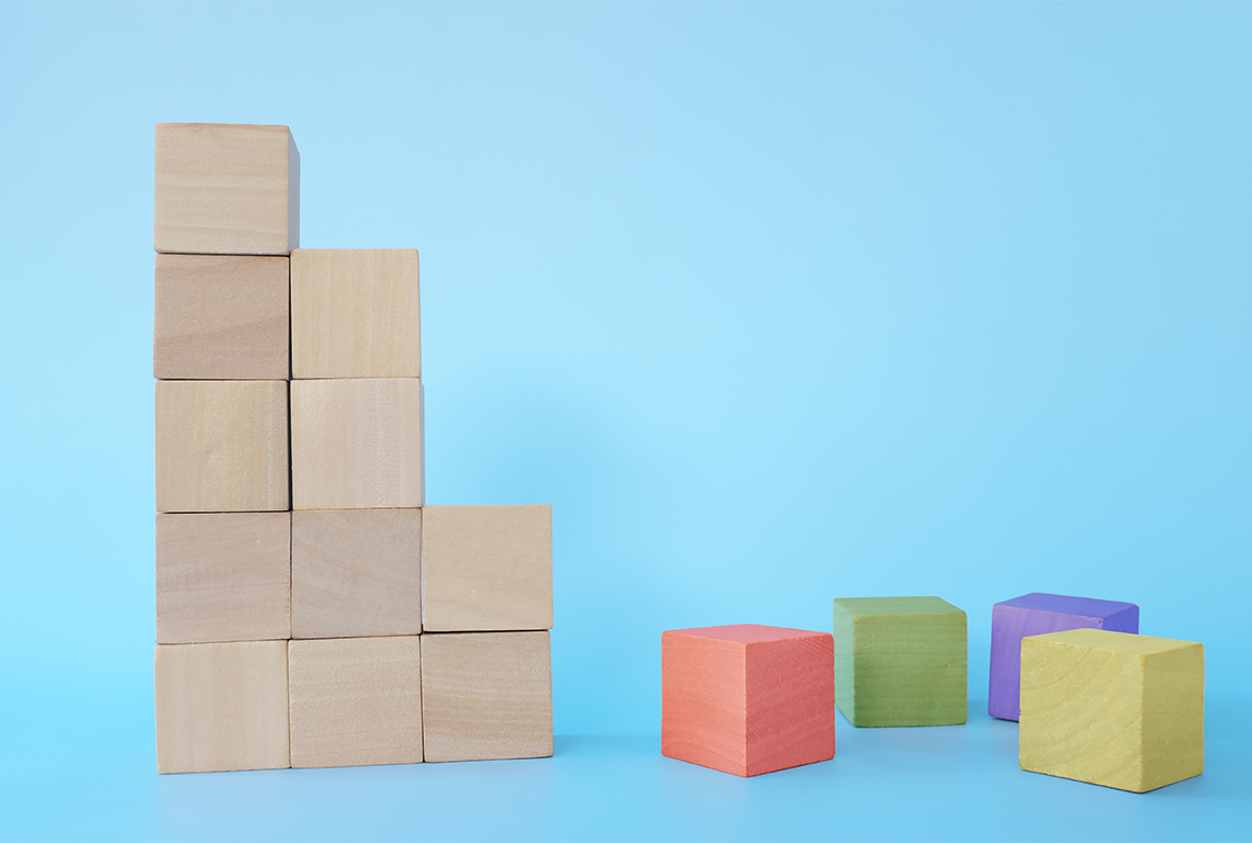zoho crm alternatives wooden blocks stacked, some discarded blocks have the zoho colors
